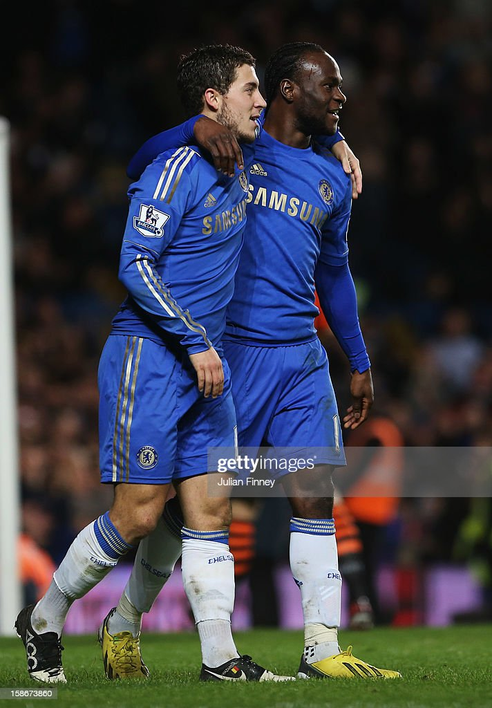 Eden Hazard of Chelsea celebrates with Victor Moses as he scores their seventh goal during the Barclays Premier League match between Chelsea and Aston Villa at Stamford Bridge on December 23, 2012 in London, England.