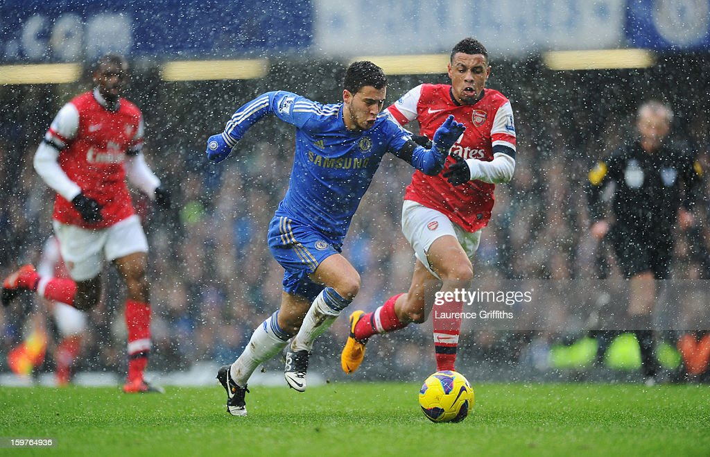 Eden Hazard of Chelsea chases the ball with Francis Coquelin of Arsenal during the Barclays Premier League match between Chelsea and Arsenal at Stamford Bridge on January 20, 2013 in London, England.