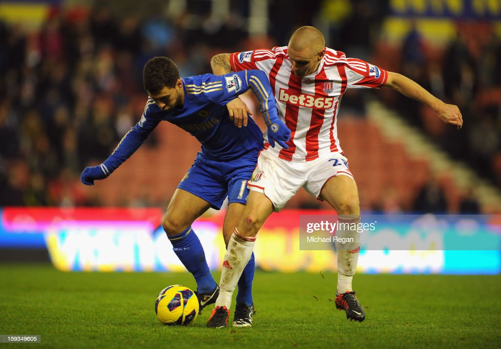 Eden Hazard of Chelsea competes with Andy Wilkinson of Stoke City during the Barclays Premier League match between Stoke City and Chelsea at the Britannia Stadium on January 12, 2013, in Stoke-on-Trent, England.
