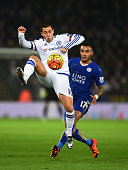 Eden Hazard of Chelsea controls the ball under pressure from Danny Simpson of Leicester City during the Barclays Premier League match between...