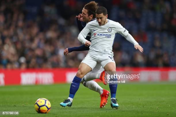 Eden Hazard of Chelsea controls the ball under pressure of Grzegorz Krychowiak of West Bromwich Albion during the Premier League match between West...