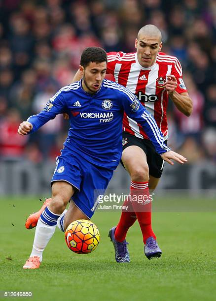 Eden Hazard of Chelsea controls the ball under pressure of Oriol Romeu of Southampton during the Barclays Premier League match between Southampton...