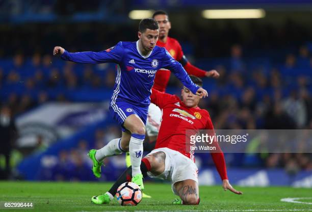 Eden Hazard of Chelsea evades Marcos Rojo of Manchester United during The Emirates FA Cup QuarterFinal match between Chelsea and Manchester United at...