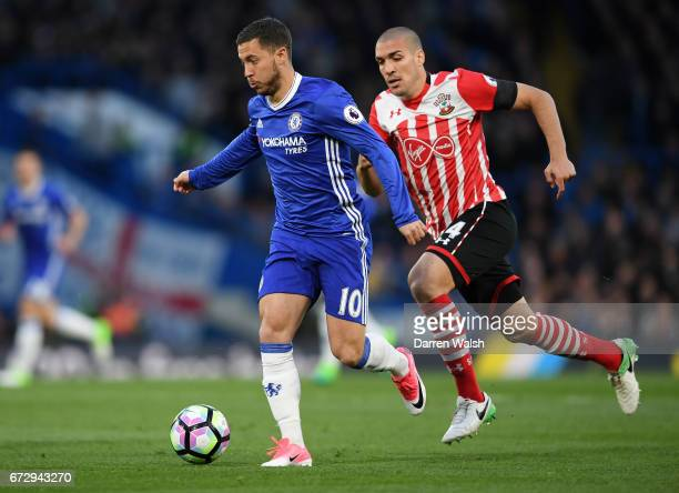 Eden Hazard of Chelsea evades Oriol Romeu of Southampton during the Premier League match between Chelsea and Southampton at Stamford Bridge on April...