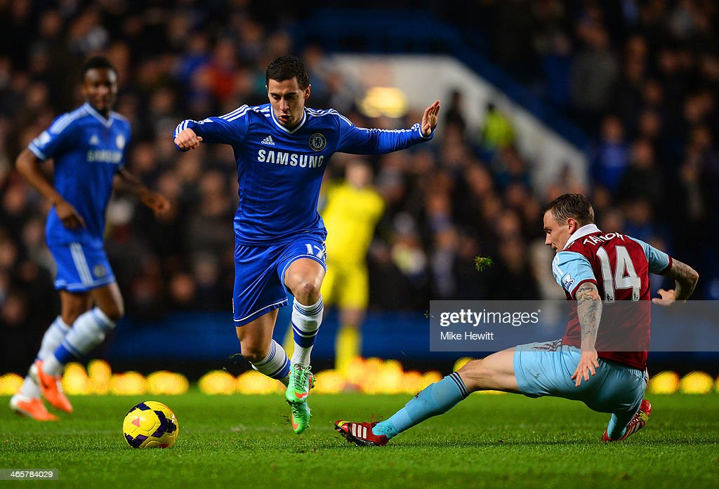 <a gi-track='captionPersonalityLinkClicked' href=/galleries/search?phrase=Eden+Hazard&family=editorial&specificpeople=5539543 ng-click='$event.stopPropagation()'>Eden Hazard</a> of Chelsea evades the tackle from Matthew Taylor of West Ham uring the Barclays Premier League match between Chelsea and West Ham United at Stamford Bridge on January 29, 2014 in London, England.
