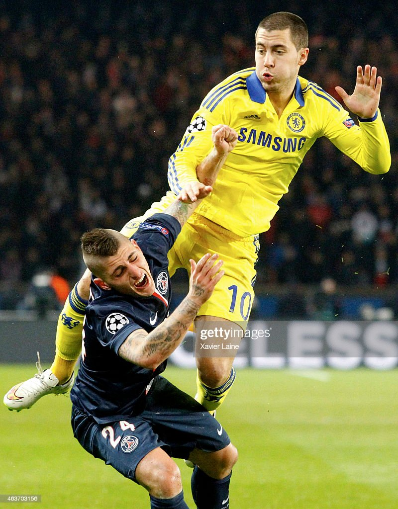 Eden Hazard of Chelsea FC clashes with Marco Verratti of Paris Saint-Germain during the UEFA Champions League Round of 16 between Paris Saint-Germain and Chelsea at Parc Des Princes on February 17, 2015 in Paris, France.