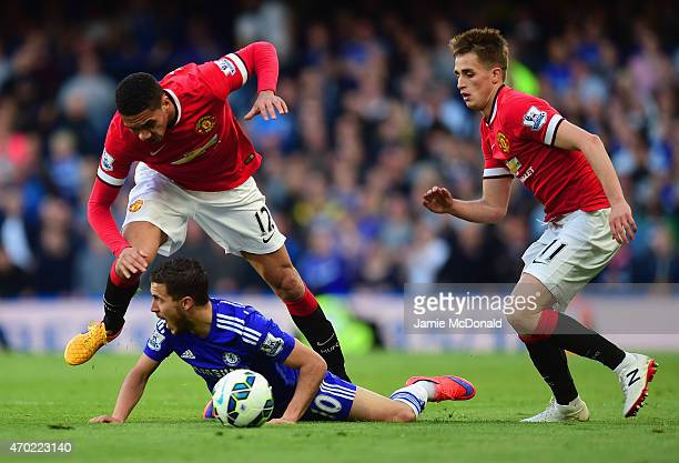 Eden Hazard of Chelsea goes to ground after a challenge from Chris Smalling of Manchester United during the Barclays Premier League match between...