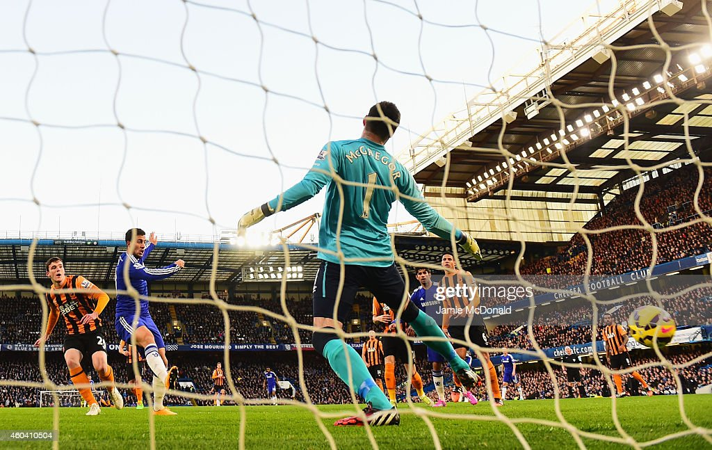 Eden Hazard of Chelsea (10) heads the ball past goalkeeper Allan McGregor of Hull City to score their first goal during the Barclays Premier League match between Chelsea and Hull City at Stamford Bridge on December 13, 2014 in London, England.