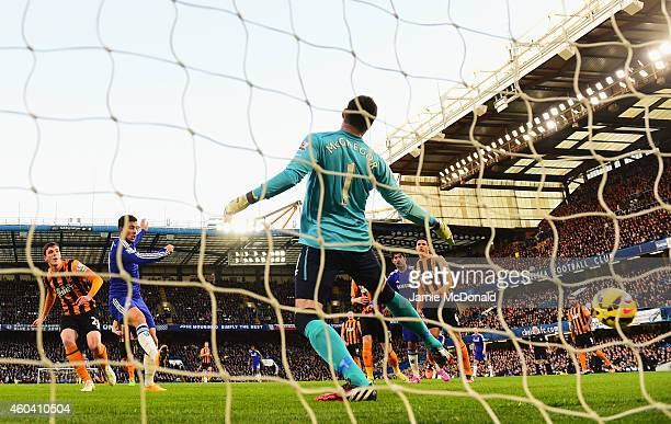 Eden Hazard of Chelsea heads the ball past goalkeeper Allan McGregor of Hull City to score their first goal during the Barclays Premier League match...