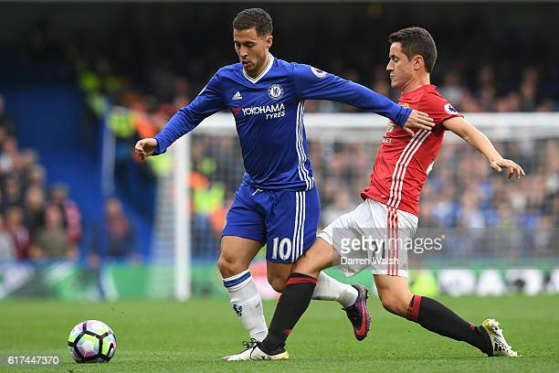 Eden Hazard of Chelsea holds off Ander Herrera of Manchester United during the Premier League match between Chelsea and Manchester United at Stamford...