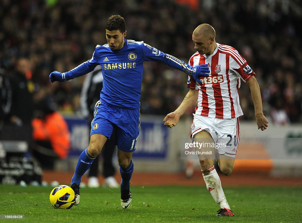 Eden Hazard of Chelsea holds off Andy Wilkinson of Stoke City during the Barclays Premier League match between Stoke City and Chelsea at the Britannia Stadium on January 12, 2013, in Stoke-on-Trent, England.