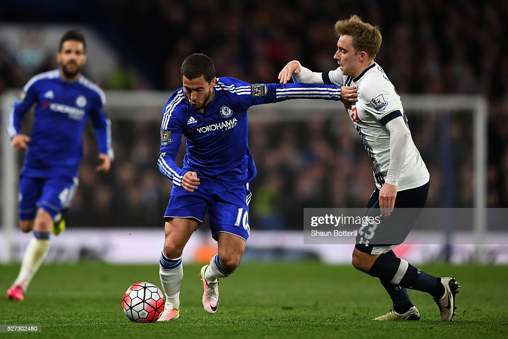 Eden Hazard of Chelsea holds off Christian Eriksen of Tottenham Hotspur during the Barclays Premier League match between Chelsea and Tottenham Hotspur at Stamford Bridge on May 02, 2016 in London, England.jd