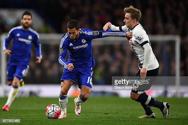 Eden Hazard of Chelsea holds off Christian Eriksen of Tottenham Hotspur during the Barclays Premier League match between Chelsea and Tottenham...