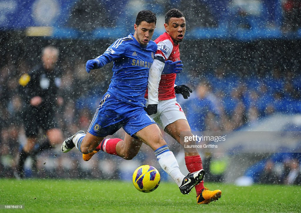 Eden Hazard of Chelsea holds off Francis Coquelin of Arsenal during the Barclays Premier League match between Chelsea and Arsenal at Stamford Bridge on January 20, 2013 in London, England.