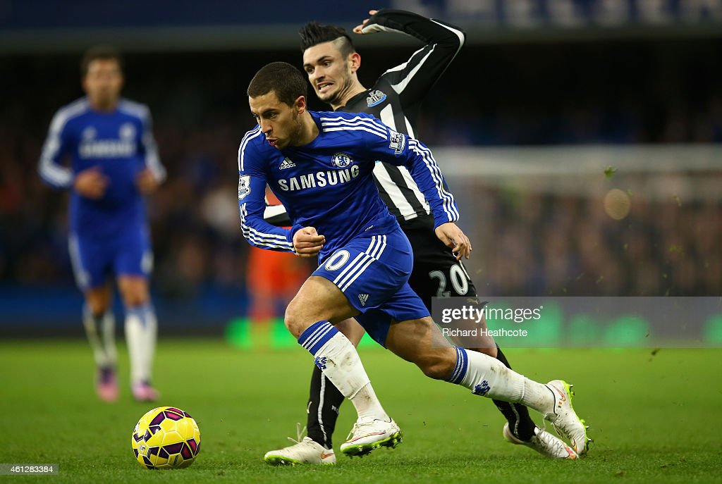 Eden Hazard of Chelsea holds off Remy Cabella of Newcaslte during the Barclays Premier League match between Chelsea and Newcastle United at Stamford Bridge on January 10, 2015 in London, England.