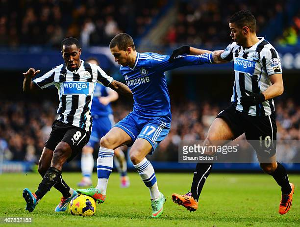 Eden Hazard of Chelsea holds off the challenge of Vurnon Anita and Hatem Ben Arfa of Newcastle United during the Barclays Premier League match...