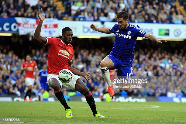 Eden Hazard of Chelsea in action with Tyler Blackett of Manchester United during the Barclays Premier League match between Chelsea and Manchester...