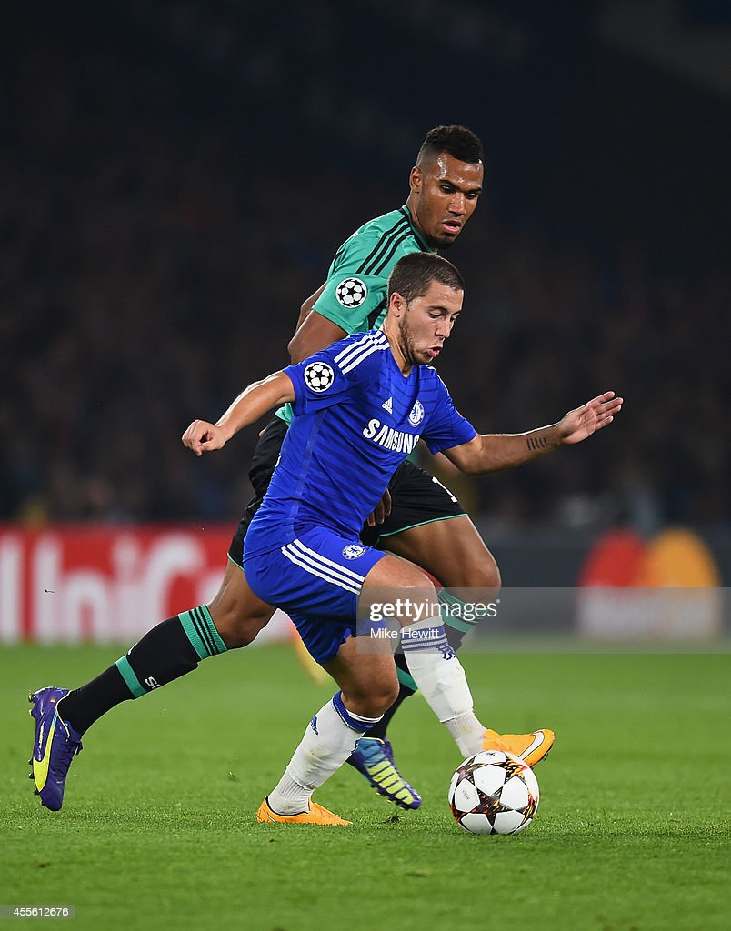 Eden Hazard of Chelsea is challenged by Eric Maxim Choupo-Moting of Schalke during the UEFA Champions League Group G match between Chelsea FC and FC Schalke 04 on September 17, 2014 in London, United Kingdom.