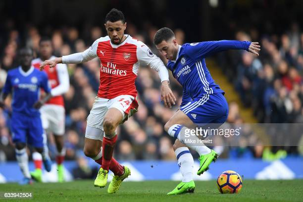 Eden Hazard of Chelsea is challenged by Francis Coquelin of Arsenal during the Premier League match between Chelsea and Arsenal at Stamford Bridge on...