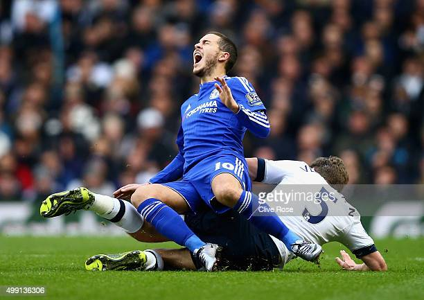 Eden Hazard of Chelsea is challenged by Jan Vertonghen of Tottenham Hotspur during the Barclays Premier League match between Tottenham Hotspur and...