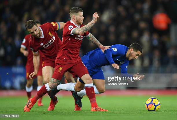 Eden Hazard of Chelsea is challenged by Jordan Henderson and Alberto Moreno of Liverpool during the Premier League match between Liverpool and...