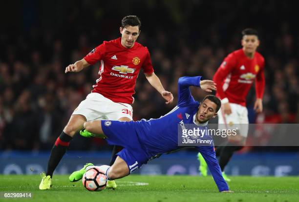 Eden Hazard of Chelsea is challenged by Matteo Darmian of Manchester United during The Emirates FA Cup QuarterFinal match between Chelsea and...