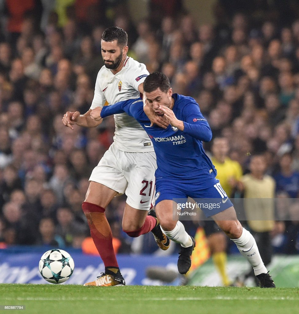 Eden Hazard of Chelsea is challenged by Maxime Gonalons of Roma during the UEFA Champions League match between Chelsea v AS Roma at Stamford Bridge Stadium, London, United Kingdom on 18 October 2017.