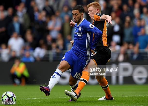 Eden Hazard of Chelsea is challenged by Sam Clucas of Hull City during the Premier League match between Hull City and Chelsea at KCOM Stadium on...