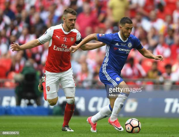 Eden Hazard of Chelsea is chased down by Aaron Ramsey of Arsenal during The Emirates FA Cup Final between Arsenal and Chelsea at Wembley Stadium on...
