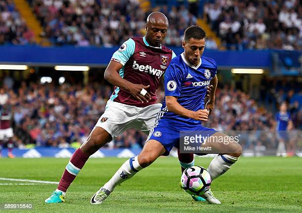 Eden Hazard of Chelsea is closed down by Andre Ayew of West Ham United during the Premier League match between Chelsea and West Ham United at...