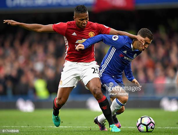 Eden Hazard of Chelsea is closed down by Antonio Valencia of Manchester United during the Premier League match between Chelsea and Manchester United...