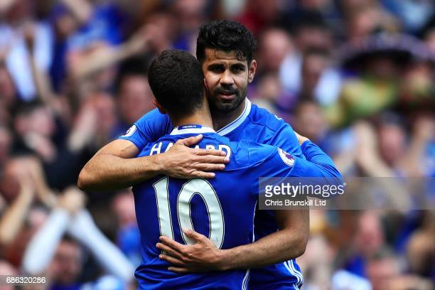 Eden Hazard of Chelsea is congratulated by teammate Diego Costa after scoring his side's second goal during the Premier League match between Chelsea...