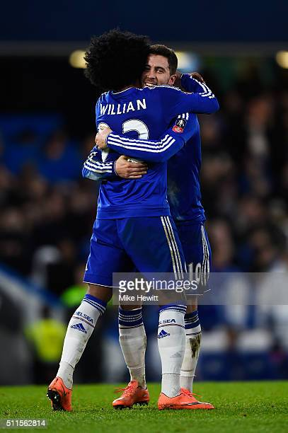 Eden Hazard of Chelsea is congratulated by teammate Willian after scoring his team's fourth goal during The Emirates FA Cup fifth round match between...