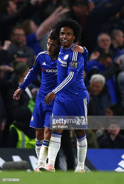 Eden Hazard of Chelsea is congratulated by teammate Willian after scoring his team's second goal during the Barclays Premier League match between...