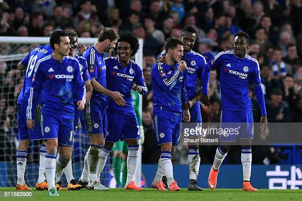 Eden Hazard of Chelsea is congratulated by teammates after scoring his team's fourth goal during The Emirates FA Cup fifth round match between...