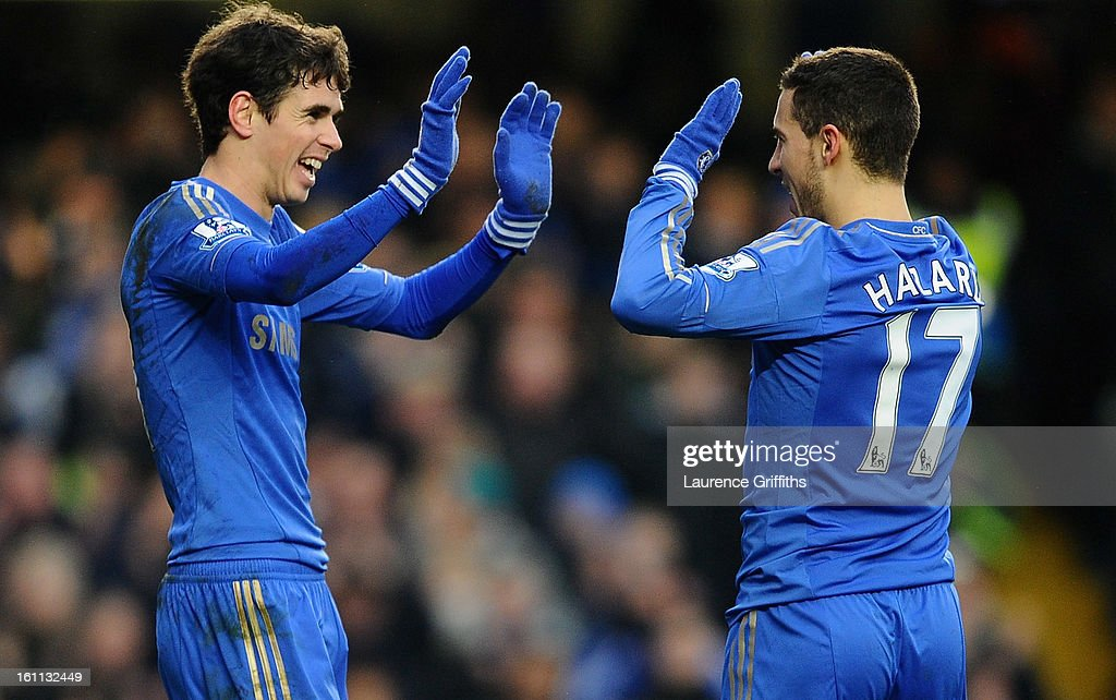 Eden Hazard of Chelsea is congratulated on the second goal by Oscar during the Barclays Premier League match between Chelsea and Wigan Athletic at Stamford Bridge on February 9, 2013 in London, England.