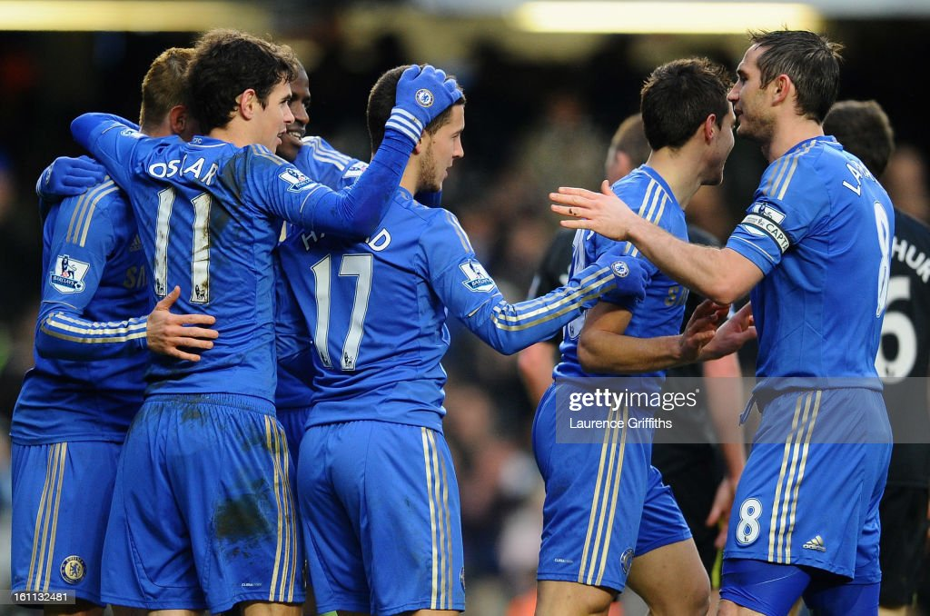 Eden Hazard of Chelsea is congratulated on the second goal during the Barclays Premier League match between Chelsea and Wigan Athletic at Stamford Bridge on February 9, 2013 in London, England.