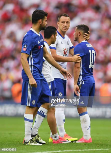 Eden Hazard of Chelsea is consoled by John Terry of Chelsea during the Emirates FA Cup Final between Arsenal and Chelsea at Wembley Stadium on May 27...