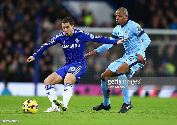 Eden Hazard of Chelsea is marshalled by Fernando of Manchester City during the Barclays Premier League match between Chelsea and Manchester City at...