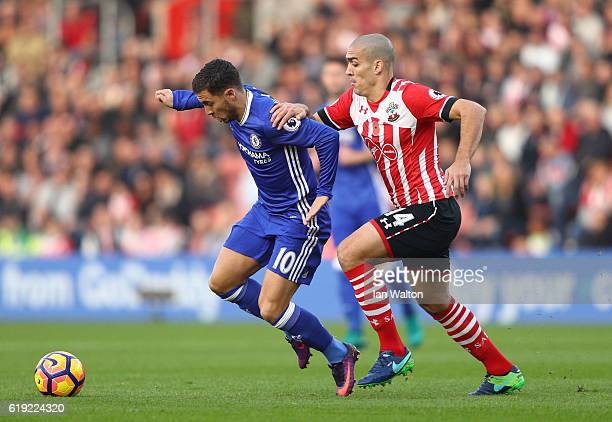 Eden Hazard of Chelsea is pulled by Oriol Romeu of Southampton during the Premier League match between Southampton and Chelsea at St Mary's Stadium...
