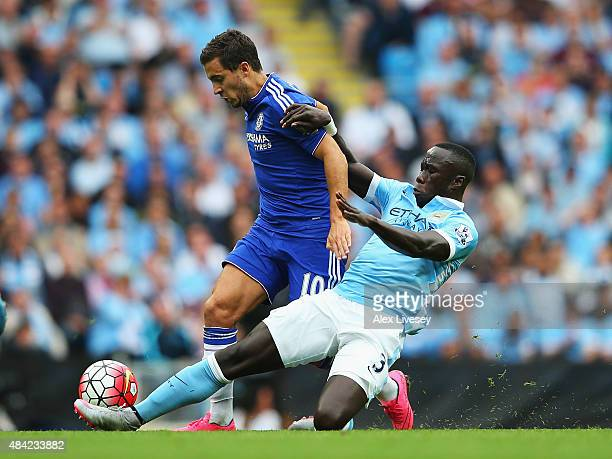 Eden Hazard of Chelsea is tackled by Bacary Sagna of Manchester City during the Barclays Premier League match between Manchester City and Chelsea at...