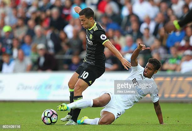Eden Hazard of Chelsea is tackled by Kyle Naughton of Swansea City during the Premier League match between Swansea City and Chelsea at Liberty...