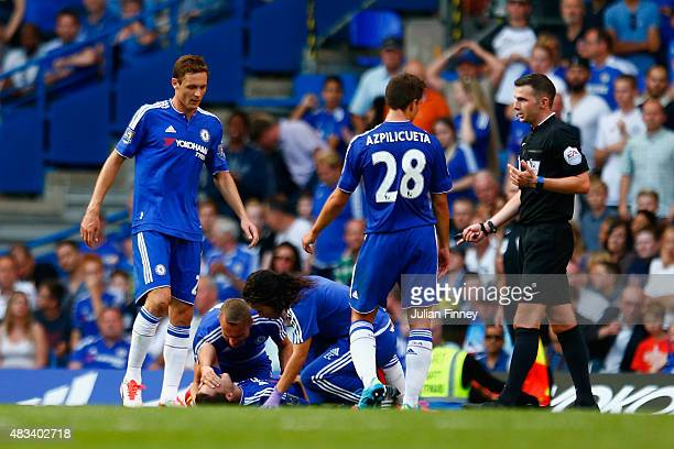Eden Hazard of Chelsea lies injured and is treated by Chelsea doctor Eva Carneiro and head physio Jon Fearn during the Barclays Premier League match...