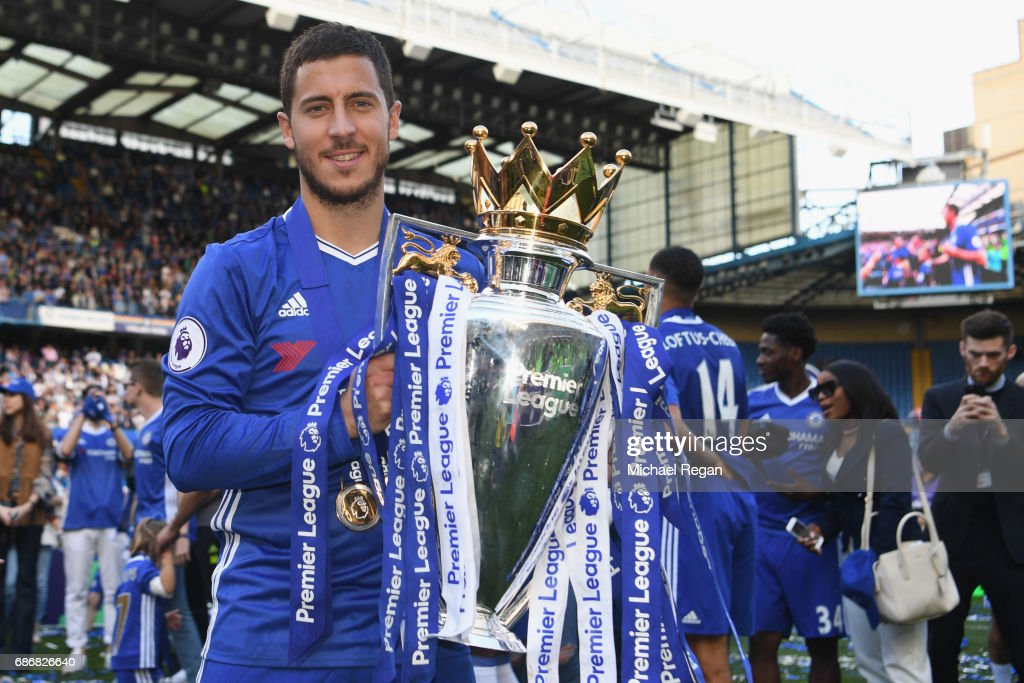 Eden Hazard of Chelsea poses with the Premier League trophy after the Premier League match between Chelsea and Sunderland at Stamford Bridge on May 21, 2017 in London, England.