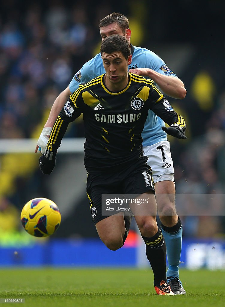 Eden Hazard of Chelsea runs with the ball during the Barclays Premier League match between Manchester City and Chelsea at Etihad Stadium on February 24, 2013 in Manchester, England.