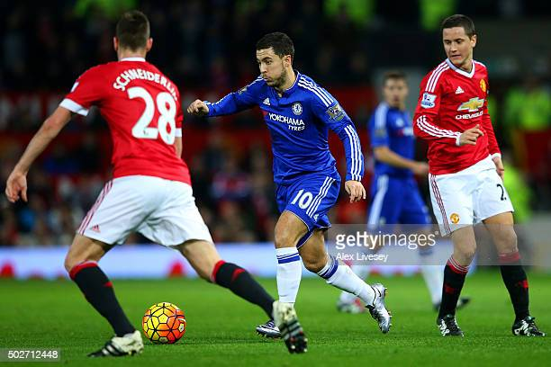 Eden Hazard of Chelsea runs with the ball towards Morgan Schneiderlin of Manchester United during the Barclays Premier League match between...