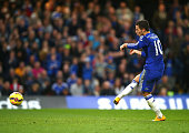 Eden Hazard of Chelsea scores from the penalty spot during the Barclays Premier League match between Chelsea and Queens Park Rangers at Stamford...