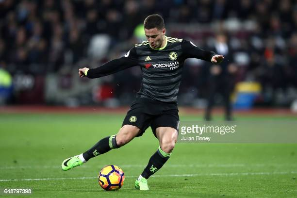 Eden Hazard of Chelsea scores his side first goal during the Premier League match between West Ham United and Chelsea at London Stadium on March 6...