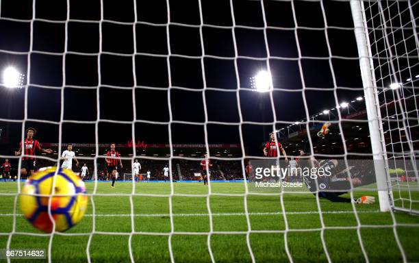 Eden Hazard of Chelsea scores his sides first goal past Asmir Begovic of AFC Bournemouth during the Premier League match between AFC Bournemouth and...