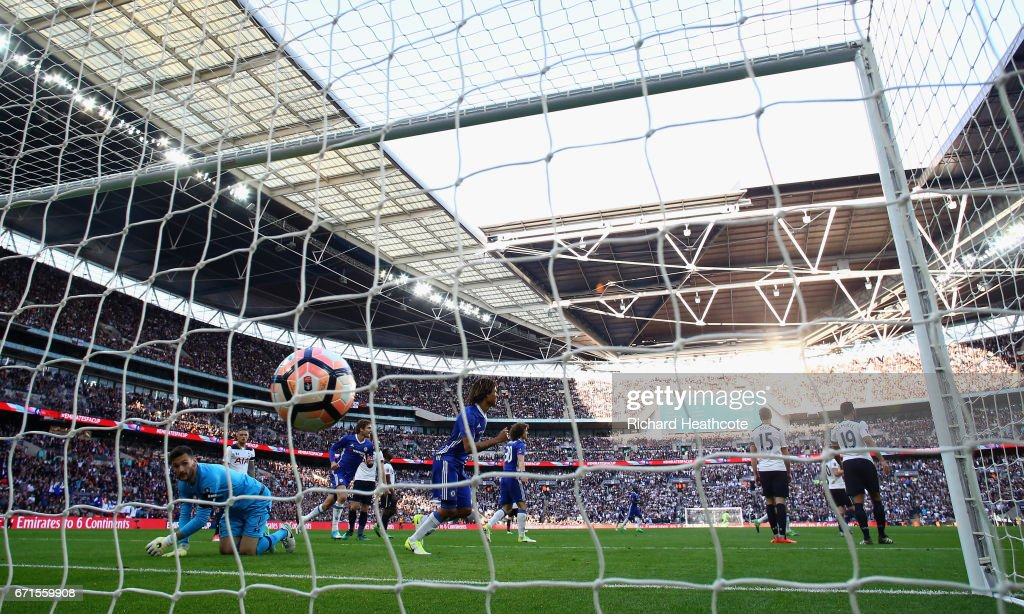 Eden Hazard of Chelsea scores his sides third goal as Hugo Lloris of Tottenham Hotspur attempts to save during The Emirates FA Cup Semi-Final between Chelsea and Tottenham Hotspur at Wembley Stadium on April 22, 2017 in London, England.